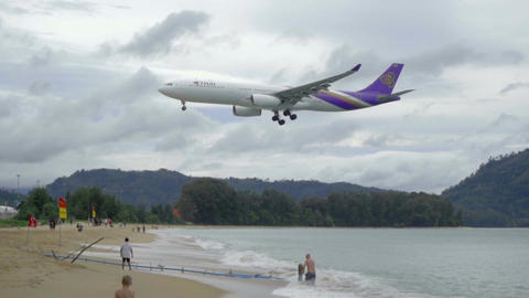 Airbus 330 approaching over ocean Live Action