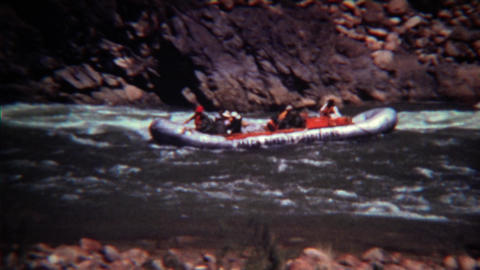 1972: Whitewater rafting guided tour down fast moving mountain river Footage