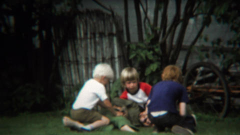 1973: Boys roughhousing in backyard playing make believe with guns Footage