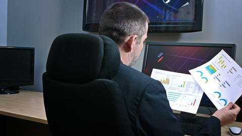 Businessman Looking at Graphs Footage
