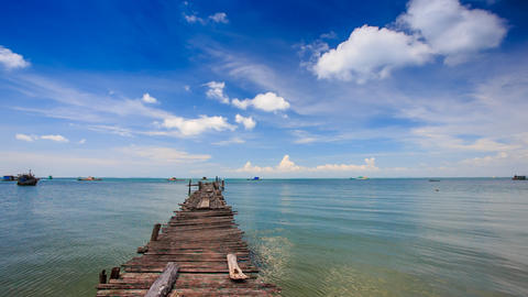 Old Wooden Pier Stretching to Azure Sea Boats at Horizon Footage