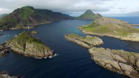 Rocky islands by Mortsund on Lofoten islands in Norway, aerial view Footage