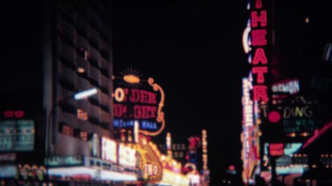 1972: Frontier hotel casino neon sign at night downtown bright lights Footage