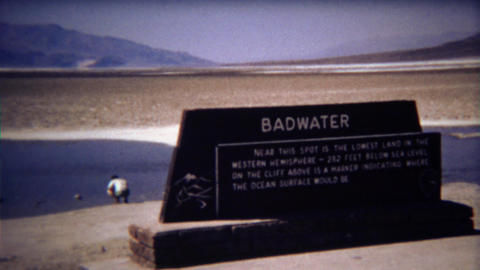1972: Man exploring just how bad the water is at Badwater park Footage