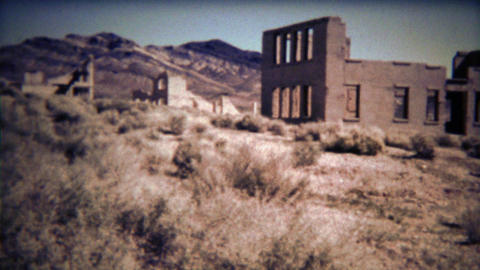 1972: Ghost Town mining camp sign and abandoned brick building ruins Footage