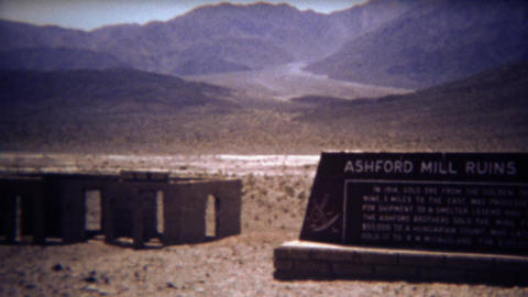 1972: Ashford Mill ruins abandoned in dry desert mountain landscape Footage