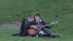 A guy and a girl on a romantic date sitting on the grass... Stock Video Footage