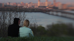 A guy and a girl on a date at sunset Footage