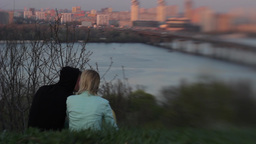 A guy and a girl on a date at sunset Stock Video Footage