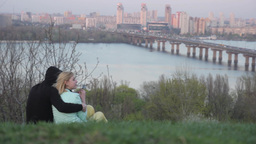 A girl and a guy on a date and the banks of the Grand river Stock Video Footage