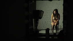 Naked girl model during a photo shoot Footage