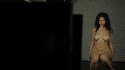 Naked girl model posing in front of the camera in the Studio Footage