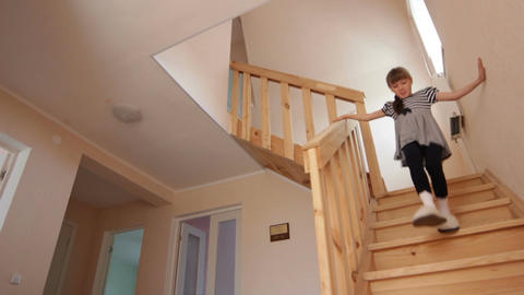Bottom View Pretty Little Girl Goes down New Nice Wooden Stairs Footage