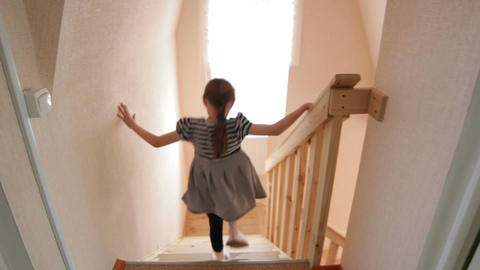 Little Girl Runs out from Children Room and Goes down Stairs Footage