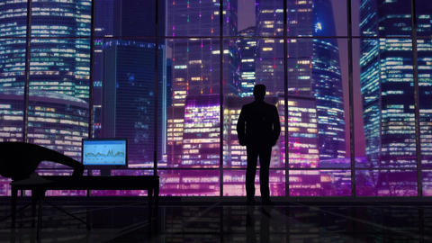Businessman in an office on a background of night skyscrapers Animation
