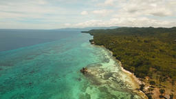 Seascape with tropical island, beach, resort, hotels. Bohol, Anda area, Philippi Footage