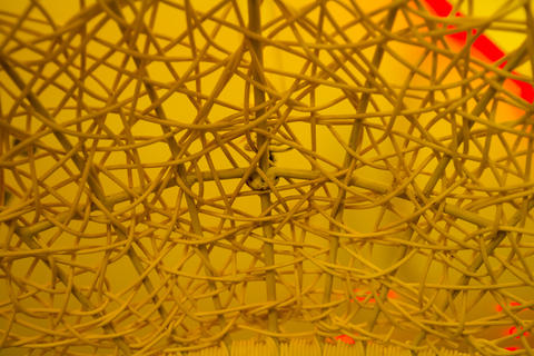 Texture of plastic rattan straw chair on color background Photo