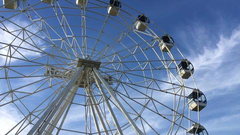 A white Ferris wheel is spinning ビデオ