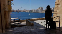 A girl and a boy at Valletta street with a view on Gzira town at Grand Harbor, M Footage