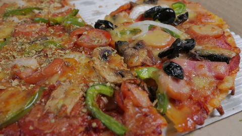 testy and delicious Italian Pizza with ham, pepper and olives in delivery box Footage