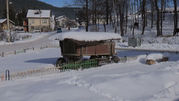 Car passing by horse cart and horses in the winter video stock footage Footage