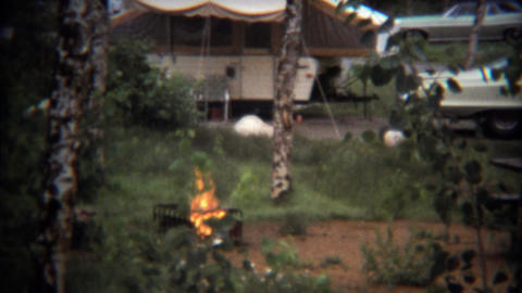 1971: Cooking fire burning at popup camper trailer site Footage