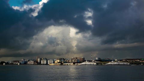 Fluffy Clouds over City and Ferry Terminal Footage