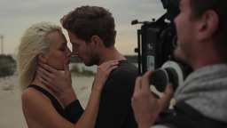 The Guy Kisses The Girl In Front Of A Camera stock footage