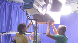 Install a large lighting fixture in movie Studio Footage