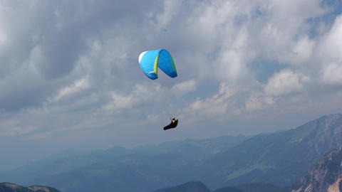 Paraglider and Clouds over the Mountains Footage