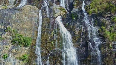 Close Aerial View Waterfall Streams Run along Rocks Footage