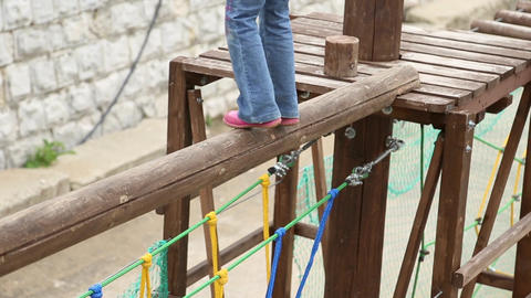 Girl overcomes a challenging obstacle Footage