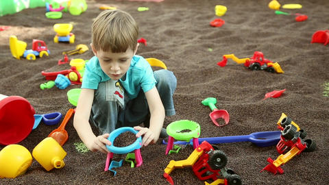A boy plays on children's educational playground Footage