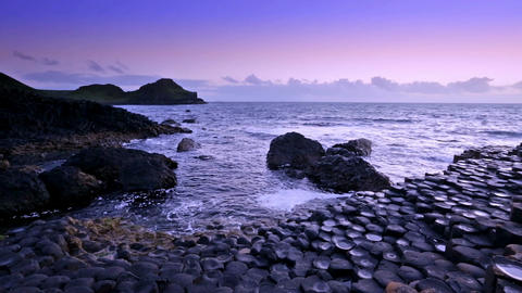 sunset over rocks formation Giant's Causeway, County Antrim, Northern Ireland Footage