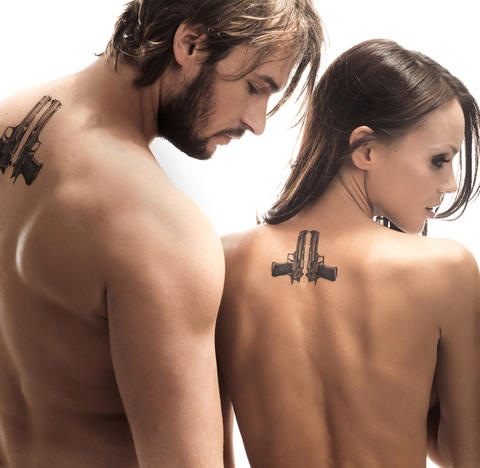 Portrait of nude couple with back tattoos フォト