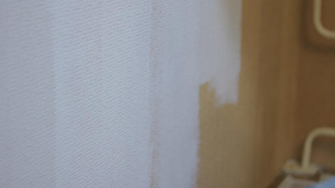 roller painting wall Stock Video Footage
