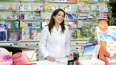 Pharmacist selling medicine to client in pharmacy Stock Video Footage