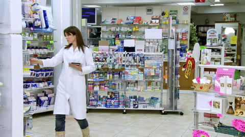 Beautiful pharmacist working with tablet Stock Video Footage