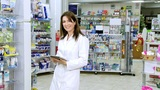 Beautiful Pharmacist Working With Tablet stock footage