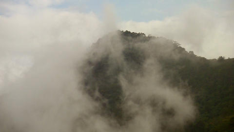 Clouds over mountain 02 Stock Video Footage