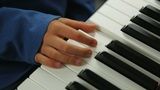 Child learning the piano Footage