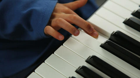 Child learning the piano Stock Video Footage