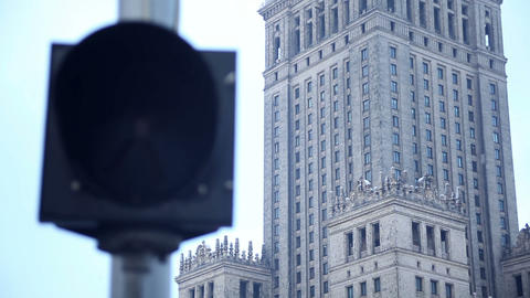 Pedestrian orange signal in front of Palace of Culture Stock Video Footage