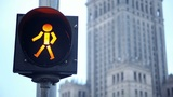 Pedestrian orange signal in front of Palace of Culture Footage