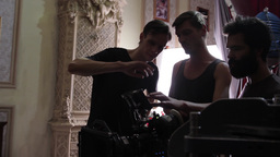 The cameraman talks with the filmmaker on shooting. Film shooting Footage