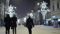 Groups of people walking on a city center street in a beautiful winter evening w Footage