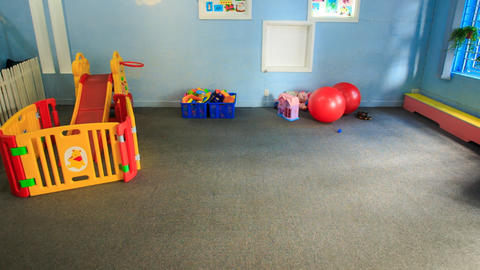 Toys Balls on Floor in Kindergarten Move to Wall Live Action