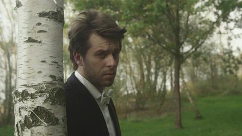 Handsome groom among greenery Footage