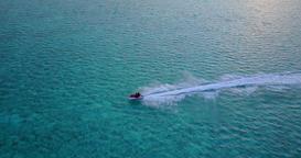 v06185 Aerial flying drone view of Maldives white sandy beach jetski riding sunn Footage
