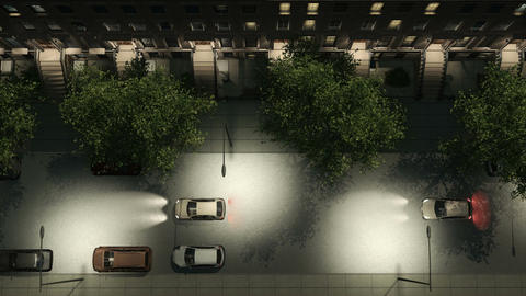 Night city street with brownstones and cars aerial Animation